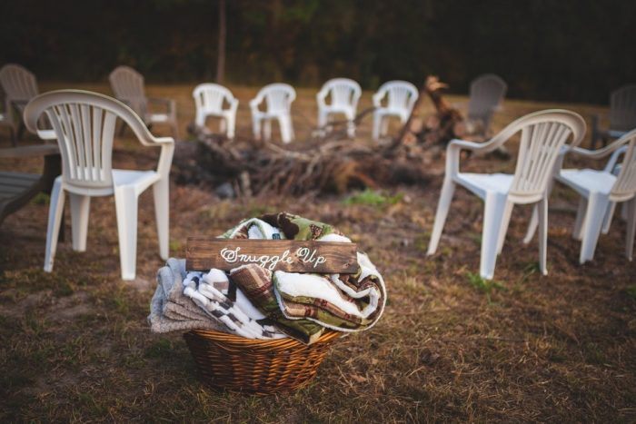 chairs and basket of blankets outdoors