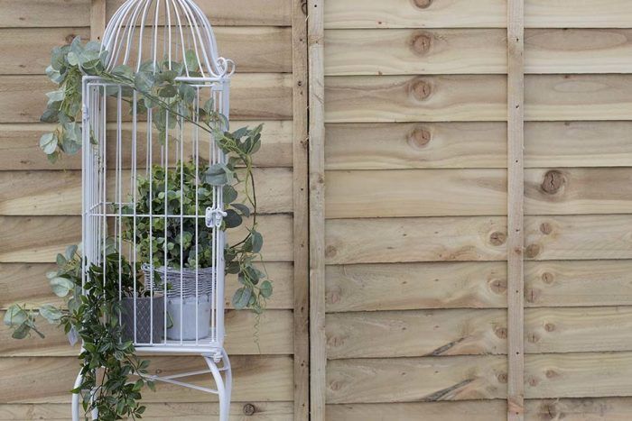 ornamental birdcage accessorised with artificial plants