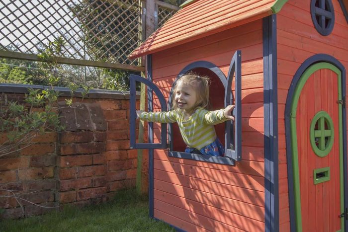 Child playing with playhouse
