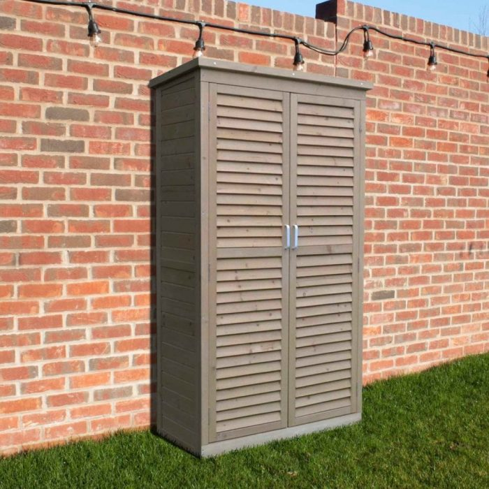 Tall wooden garden storage shed with shelves